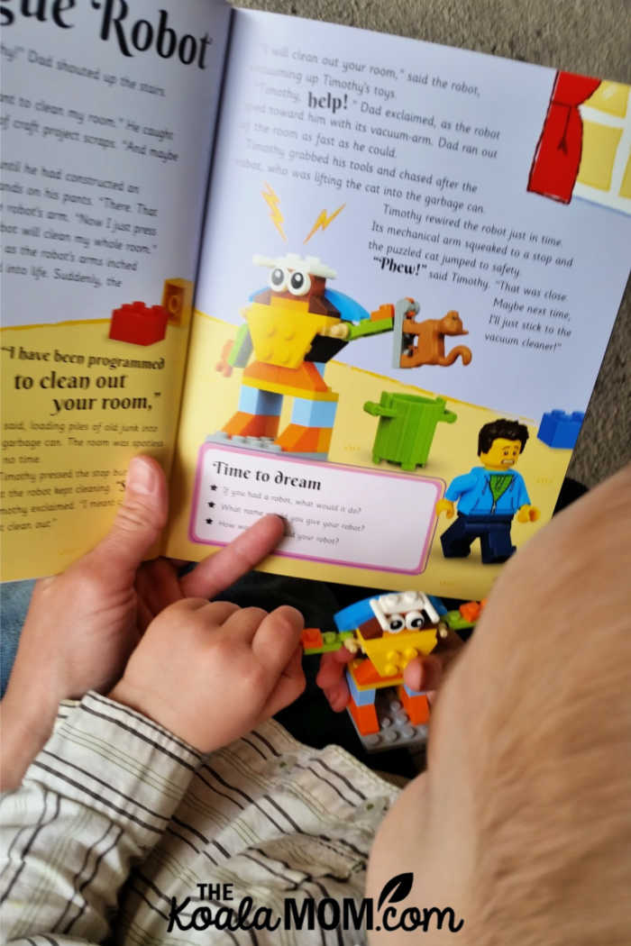 Two-year-old reading a story about his Lego model with Mommy.