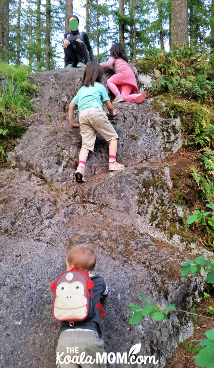 Kids climbing a rock in Minnekhada Park