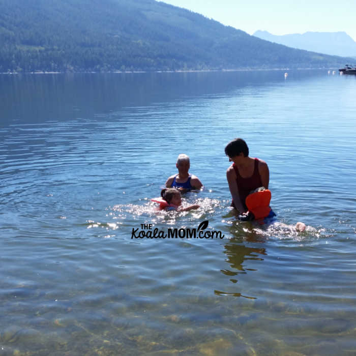 Mom and Grandma swimming with kids in Shuswap Lake.