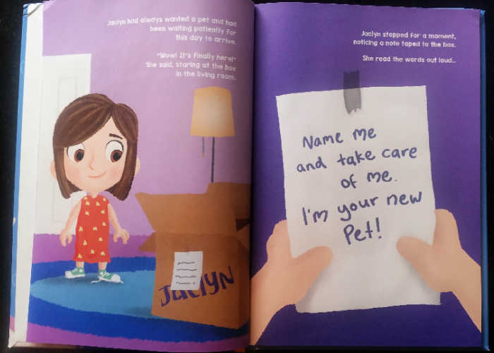 """An inside page of """"Me and My New Pet: How We First Met,"""" showing a girl getting a big box with a note that says, """"Name me and take care of me. I'm your new pet!"""""""