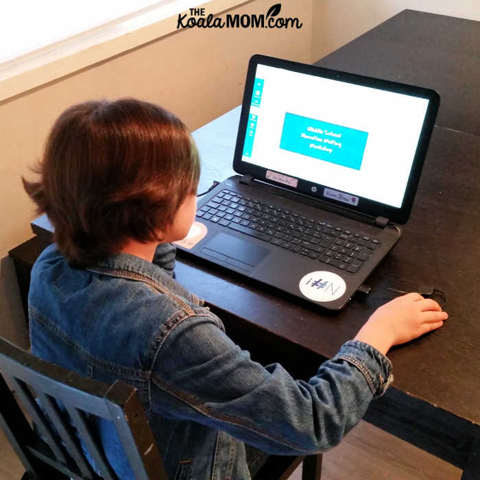 10-year-old looks at her Middle School Narrative Writing Workshop from WriteAtHome.