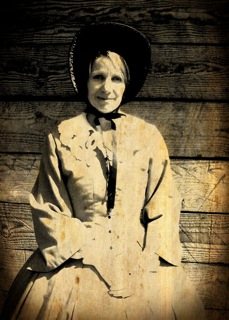 """Author Vanessa Winn as """"Miss Work"""" at Fort Nisqually."""