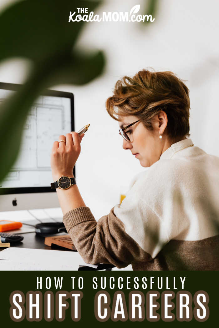 A woman sits at her computer with a pen in hand and notebooks on her desk, considering how to shift her career.