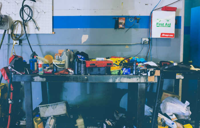 9 Signs That You're Living in a Cluttered Home - you can't fit your car into your garage, like this cluttered garage.