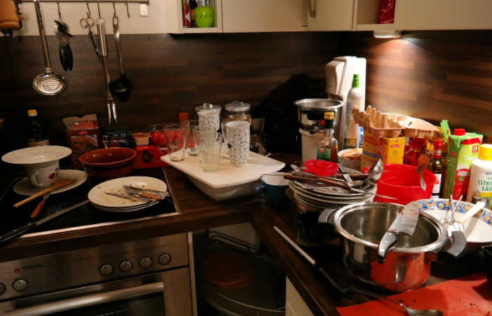 9 Signs That You're Living in a Cluttered Home - there are dirty dishes everywhere, like this cluttered kitchen.