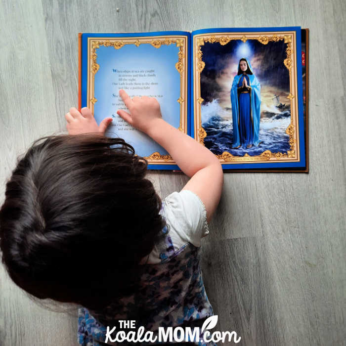 5-year-old Pearl reading Our Lady's Picture Book by Anthony DeStefano