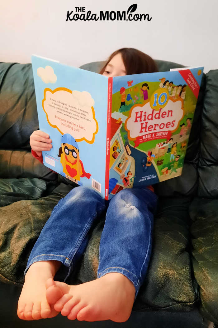 5-year-old reads 10 Hidden Heroes by Mark K. Shriver.