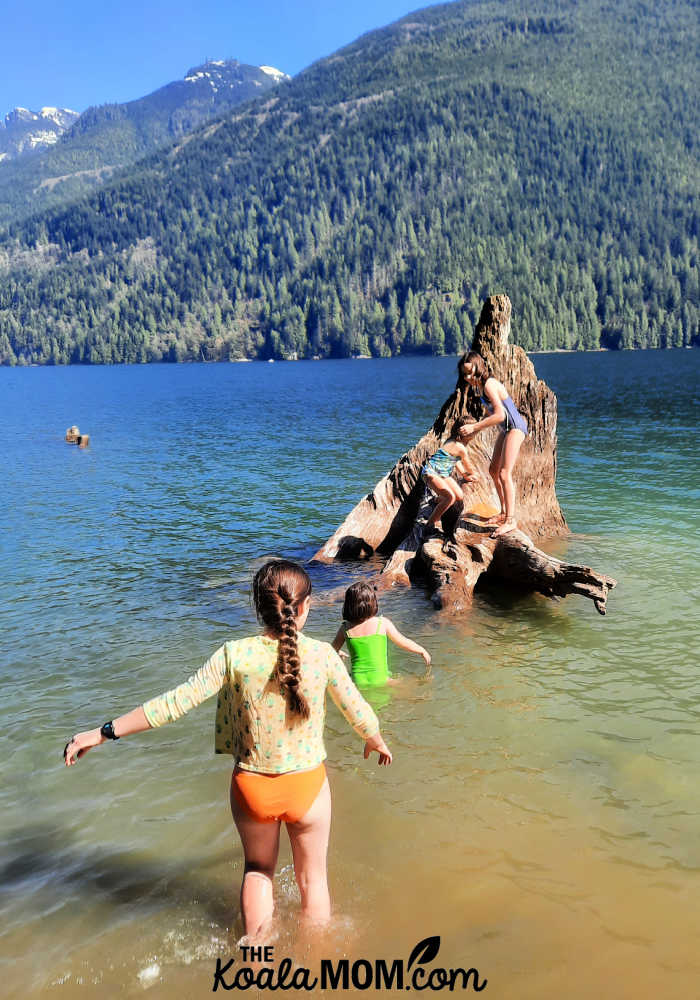 Four sisters swimming in Alouette Lake.