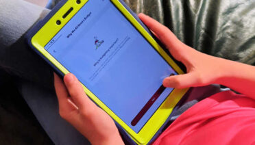 11-year-old playing the money trivia games in the Mydoh app.